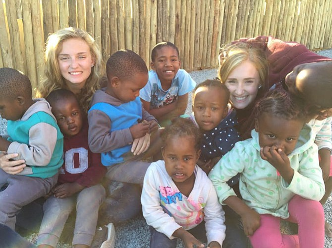 Taylor and Samantha Lane with orphans in Swaziland.