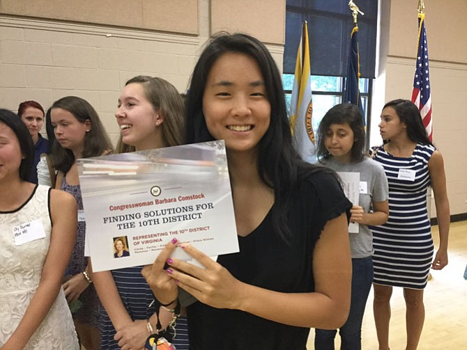 Karis Yu, a rising junior at Oakton High School, holds the certificate she received during the Aug. 17 session of Comstock's  Tenth Congressional District Young Women Leadership Program.