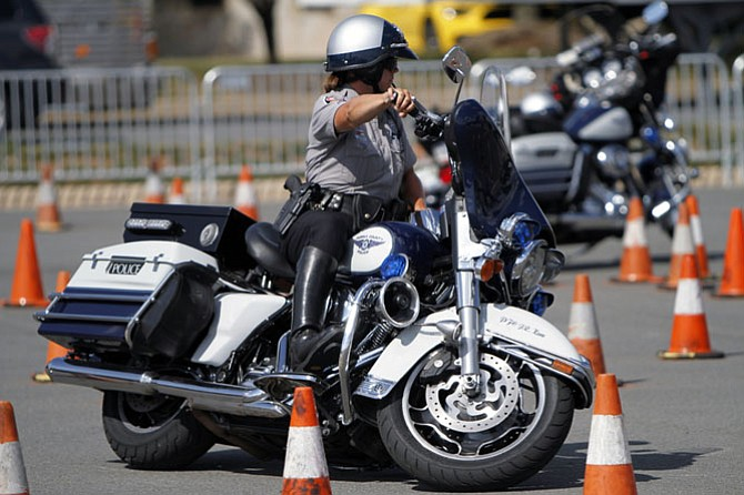 PFC Jessica Kane with the Fairfax County Police Motor Squad practices for police motorcycle rodeo on Aug. 18.