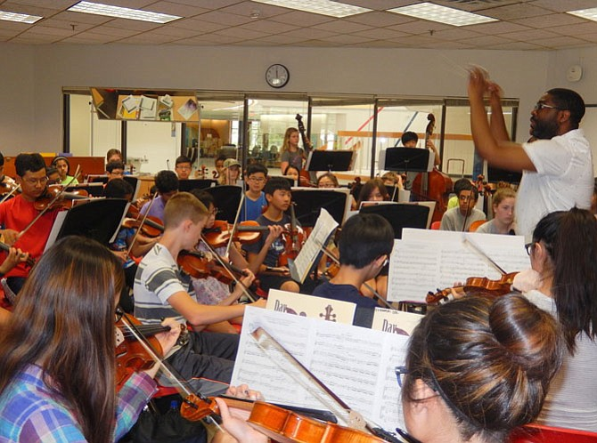 Rocky Run Middle Orchestra Director Stephen Matthie conducts the highest-level orchestra at the camp.