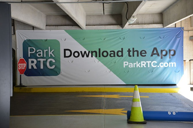 The signage for the new pay-to-park system at Reston Town Center. Many residents oppose the change.