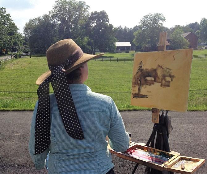 """Plein Air Competition Juror Jill Banks paints """"en plein air."""""""