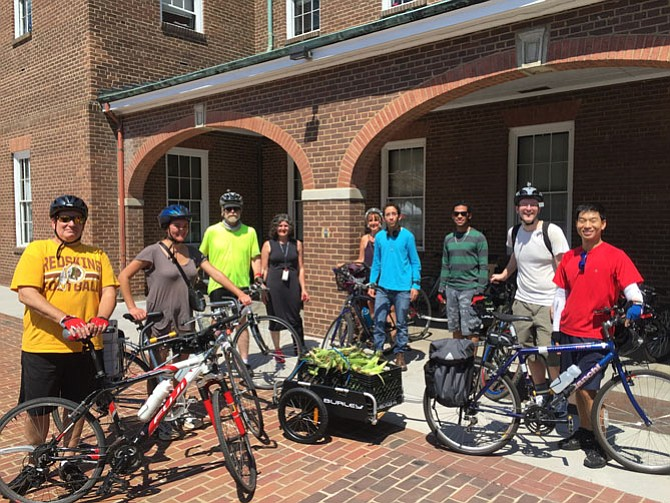 Volunteers prepare for their bike trip to deliver food to the Annie B. Rose home.