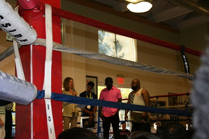 Mayor Allison Silberberg praises Olympian boxer Shakur Stevenson at the Alexandria Boxing Club.