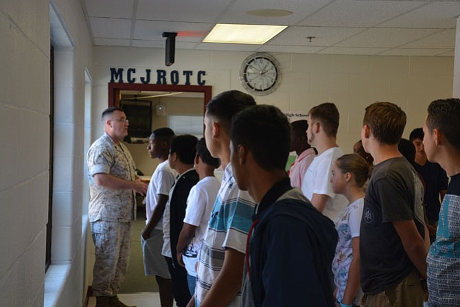 Gunnery Sgt. Gordon (left) welcomes new cadets for first-year Marine JROTC class at Mount Vernon High School on the first day of classes, Sep. 6.