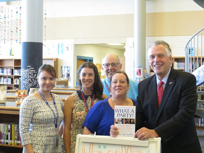 Gov. Terry McAuliffe with T.C. Williams library staff.