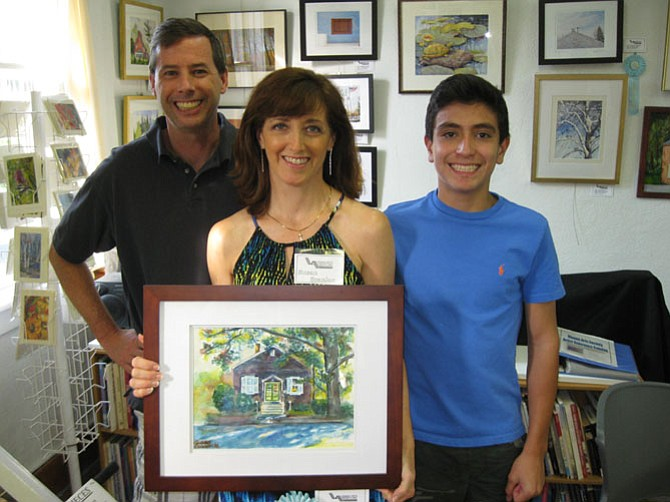 "Susan Scanlon with husband Tom and son Dylan received Honorable Mention for her piece, ""Vienna Arts Society House."""