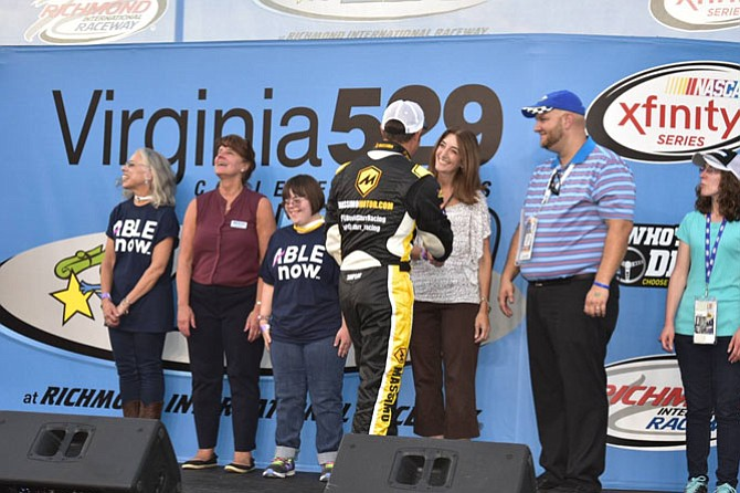 Del. Eileen Filler-Corn, Natalie and Catherine Beck, and Virginia 529 CEO Mary Morris shaking the hands of the drivers before the race.