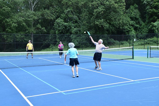 Pete McCloskey and spouse Louise return the ball to Tom and Eileen Culligan on the newly lined pickleball courts in McLean Central Park.