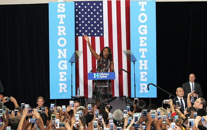 First Lady Michelle Obama waves to the crowd at the Johnson Center, George Mason University on Friday, Sept. 16.