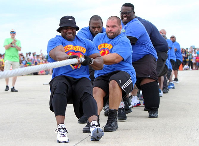 Chris Gray (front) and the rest of Chesapeake Sheriff's Office flex their muscles en route to another win. They edged out Prince William County Sheriff's Office to complete a decade of dominance.
