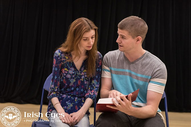 """Comic Potential,"" McLean Community Players:  From left -- Adam (Scott Duvall), a young writer, uses a Bible to teach android performer Jacie (Caity Brown), how to read."