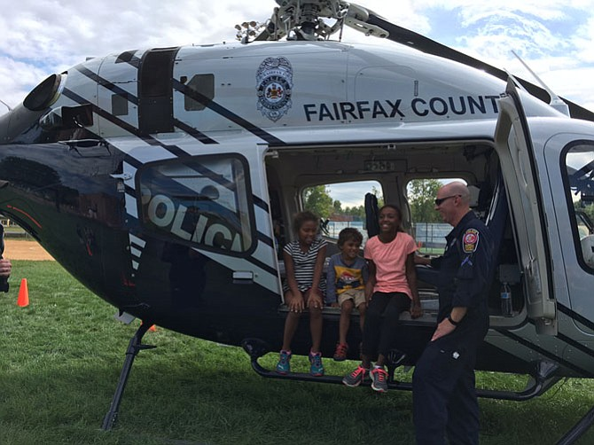 Aisha Justilien, 8, and her siblings Daniel, 4, and Maya, 11, of Vienna, giggled as they sat in the Fairfax County police helicopter.