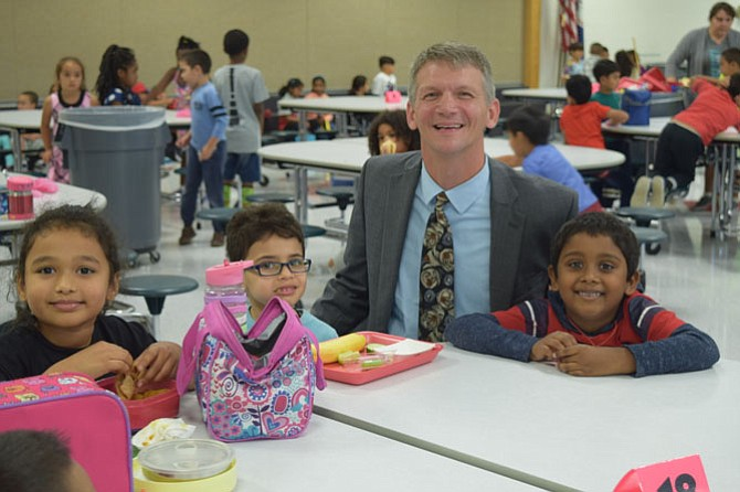 New Coates Elementary School Principal Jesse Kraft interacts with students.