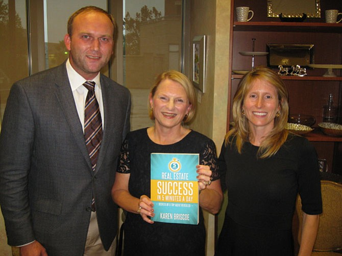 (From left): Paul Kohlenberger, president of the Greater McLean Chamber of Commerce, author Karen Briscoe of McLean, and Lizzy Conroy, her business partner of McLean.
