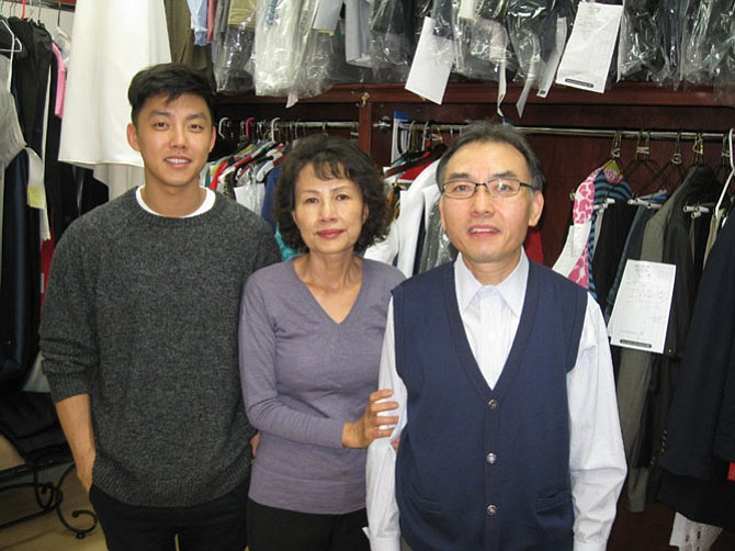 David Deuk Kim (right) with his son Philip and wife Soon Kim of Kim's Tailoring, located in the Great Falls Center Shopping Center on Georgetown Pike in Great Falls.