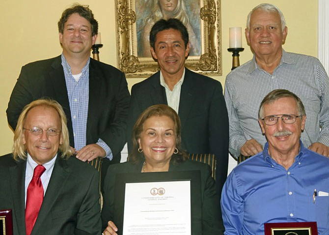 Back from left: Alfonso Lopez, Walter Tejada, Andres Tobar (executive director). Front: Charles Meng, Leni Gonzalez (chair of the SEEC Board) and Bill Murphy.