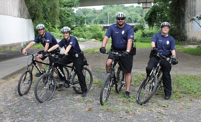 Animal Welfare League of Alexandria's Chief of Animal Services Brian Rees (second from right) with his bike patrol team (from left): Ken Howes, Megan  Boyd and Tammy Doran.