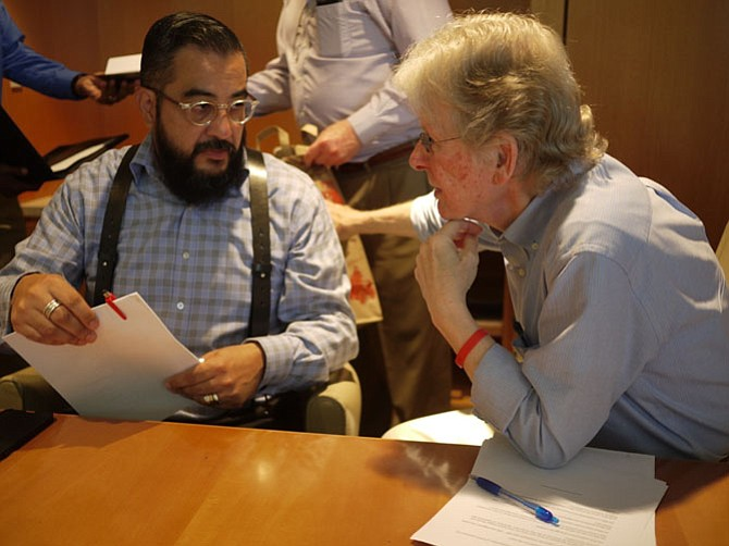 Richard Merritt and Neighborhood Health's Eduardo Mantilla-Torres discuss follow up care.
