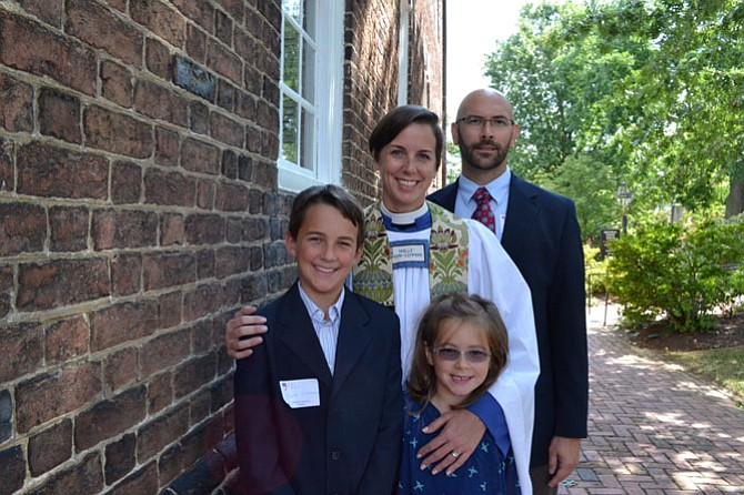 The Rev. Noelle York-Simmons on her first Sunday at Christ Church, with husband Kevin, son Eli, 10, and daughter Linden, 7.