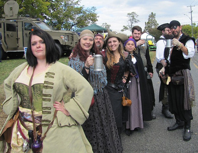 Pirates for Sail raise their tankards in a toast to Centreville Day.