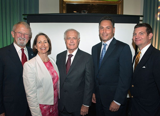 From left are John Milliken, APAH board chair and master of ceremonies; Nina Janopaul, president and CEO of APAH; David C. Leibson, co-chair of the Arlington Ten-Year Plan to End Homelessness, and APAH 2016 honoree; Timothy J. Naughton, CEO of AvalonBay Communities and APAH 2016 honoree; and Jay Harris, APAH board of directors member.