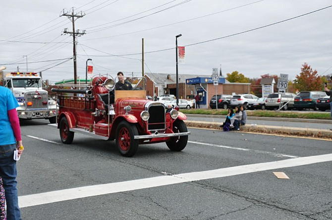 The Cabin John Park Volunteer Fire Department participates in the Potomac Day parade with its classic apparatus ...