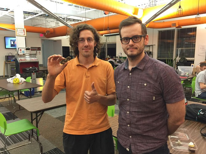 From left -- Mike Hogarty, owner of Hotrods 2 Hybrids joined with Callye Keen from Red Blue Collective to create Alpha, a new fidget toy. Photo taken at the Nova Labs site in Reston.