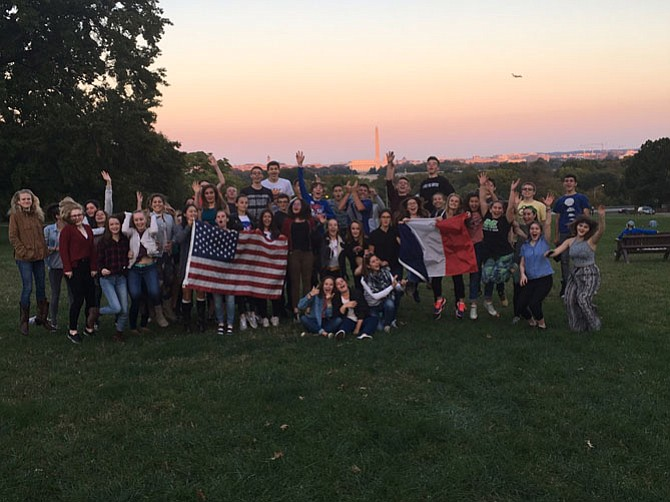 The group of students and teachers from Reims, with American friends, watched a sunset near the Iwo Jima Memorial.