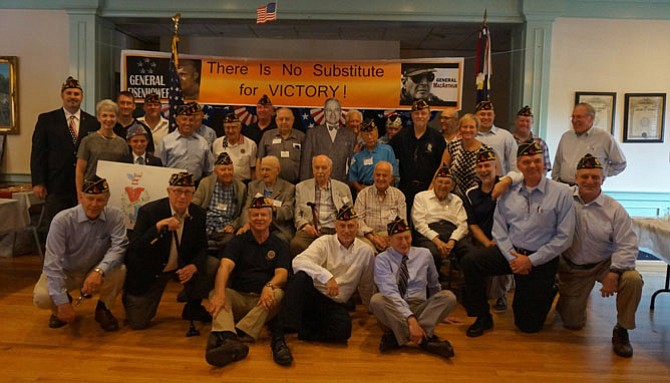 Members of American Legion Post 24, shown commemorating V-J Day with World War II veterans earlier this year, will be honored for their service to the community.