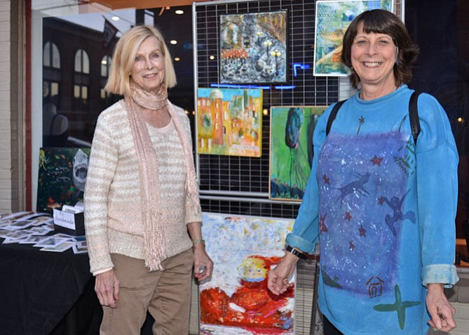 "From left -- Showing off her artistic talent in front of Copan Restaurant was artist Livingston Rodgers with ""crawler"" Virginia Glenn of Great Falls. Glenn already owns at least one piece by Rodgers, but looked ready to add to her collection."