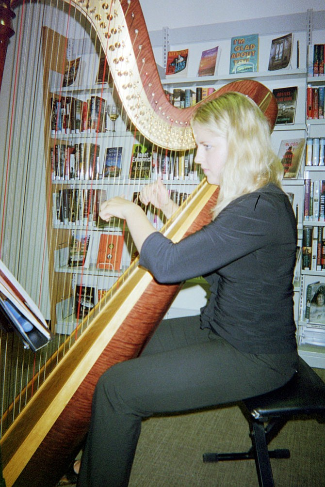 Harpist Francesca Savoia of Vienna plays for guests at the Dolley Madison Library.