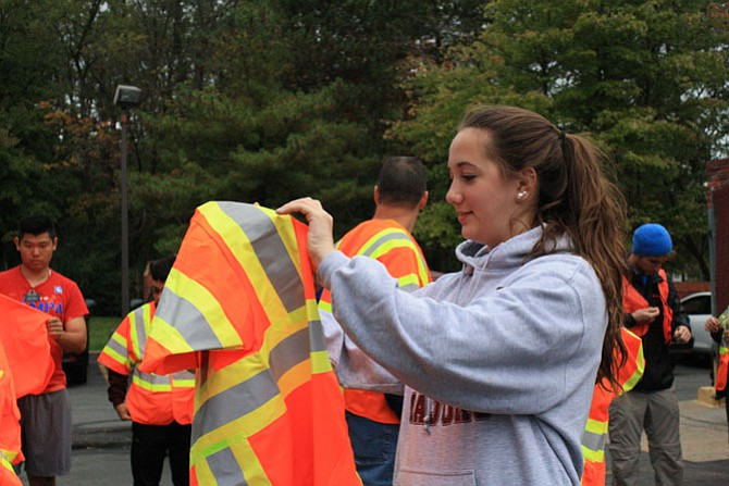 Hannah Todd dons a reflective vest before heading out to clean up the road named after her father.