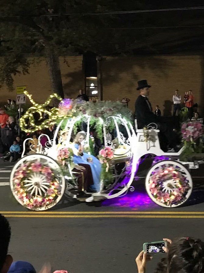 "Karin's Florist decorated a Cinderella ""pumpkin"" carriage for Cinderella and her prince to ride in … along with 8-year-old Abby Hamm who was voted by the community as the parade's very own little princess."
