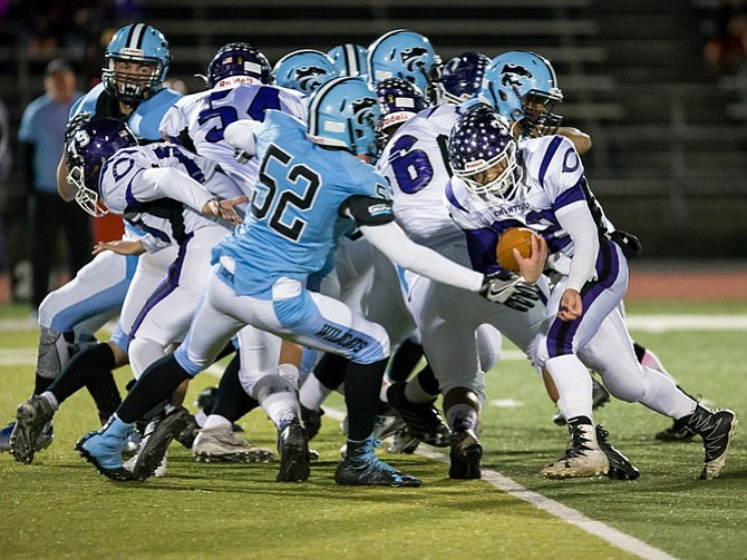 Centreville's Edward Maxwell #52 reaches for ball carried by Chantilly's Joey Imperato #32