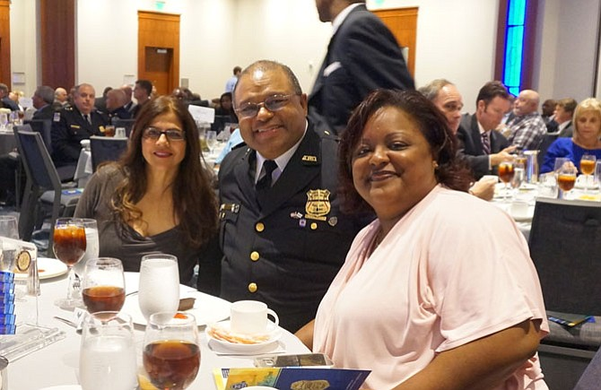 Alexandria Police Chief Earl Cook, flanked by his daughter Crystal Johnson, right, and APD division chief Brenda D'Sylva, celebrates his retirement at a luncheon Sept. 30 at the Westin Alexandria Hotel.