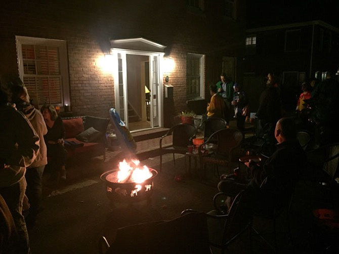 Alexandrians on Wilkes Street gather around a fire pit.