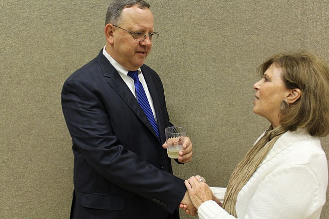 """McLean Citizens Association Board Member Bonnie Heebner, who represents Madison of McLean, congratulates Mark Zetts on his resolution. """"He was very informative, knowledgeable. I learned a lot from him,"""" she says of Zetts."""