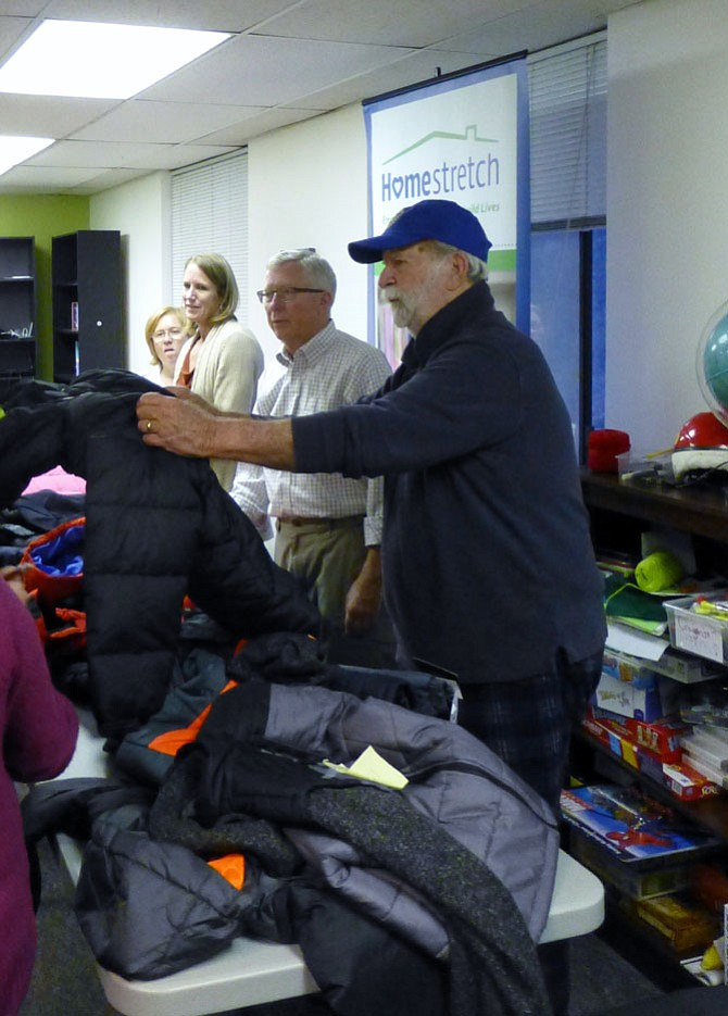 Arlington Rotary Club members give winter coats to children enrolled in Homestretch.