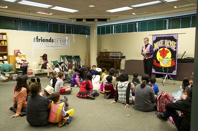 Mike Rose the Magician performs at the Potomac Library on Monday, Oct. 31.