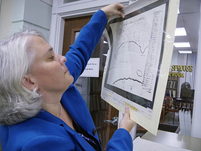 Tricia Walker pulls out a drawer of maps — Presbyterian Cemetery, Alexandria to 1760. A number of people are researching the history of their homes.