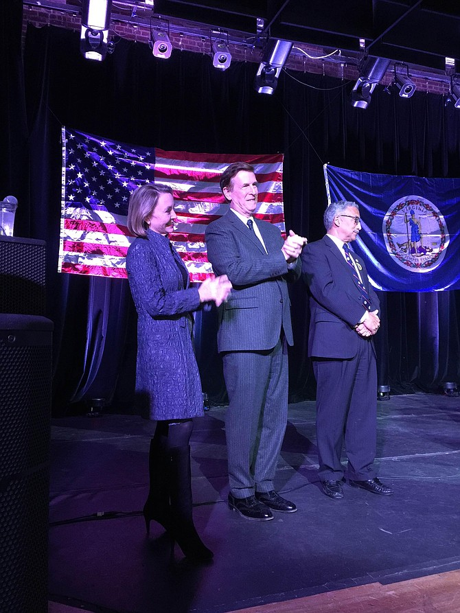 U.S. Rep. Donald Beyer (center) with his wife Megan Beyer (left) and U.S. Rep. Bobby Scott at an Election Night party held in the State Theatre in Falls Church.