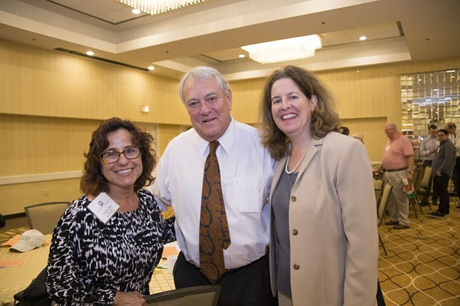 Community Lodgings board chair Marie Muscella, Union Street Public House owner Jay Test and Mayor Allison Silberberg.