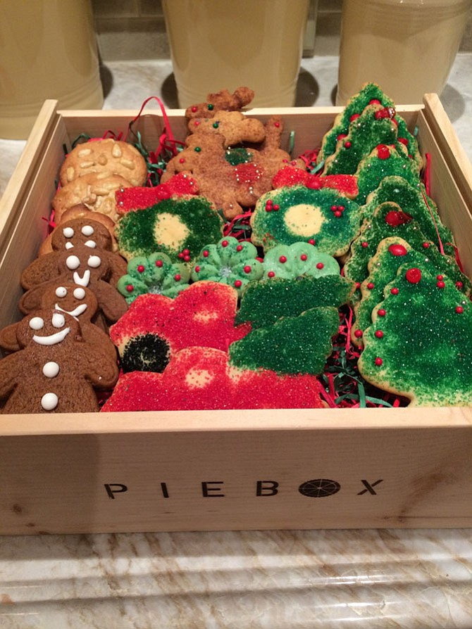 Terri Carr bakes, decorates and packages holiday cookies, which she sends to friends and family.