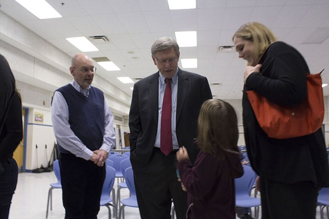 (From right) Karen Caruth, mother of first-grader Cleary Caruth, thanks Dranesville District Supervisor John Foust, and Bob Fuqua, the school's principal, for making progress on the sidewalk projects. Foust told Cleary to email him photos of her riding her bike on the sidewalks once they are finished.