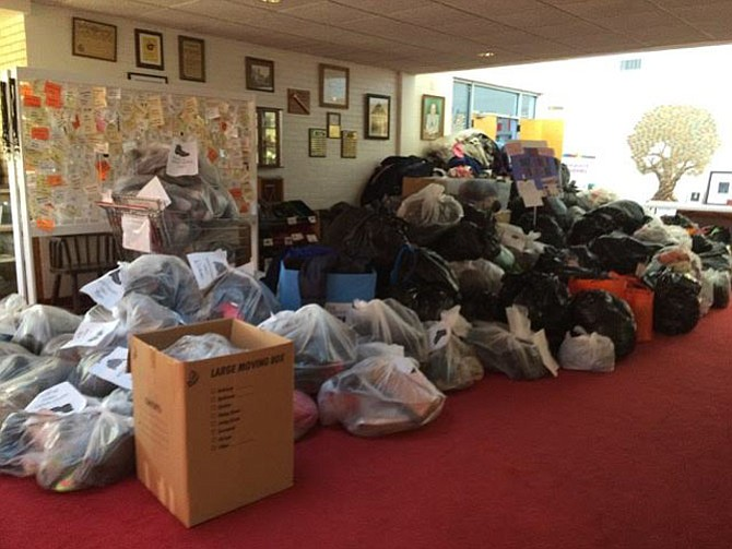 Coat donations pile up at one of LINK's previous coat drives. In 2015 the coat drive provided 2,900 used winter coats, gloves and mittens to 400 families.