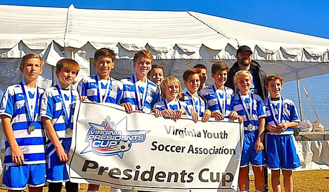 Pictured. from left, are:  Ethan Addington, Ona Sinani, Kian Ambrose, Spencer Paulsen, Collin Togher, Ryan Duenkel, Alex Mavris, Boden Gentile, Jeffrey Stark,  Aidan Connolly, Danny McGaughey and Coach Keith Osborne (missing Ryan Shiner, Eric Bellino and Max Alexander)