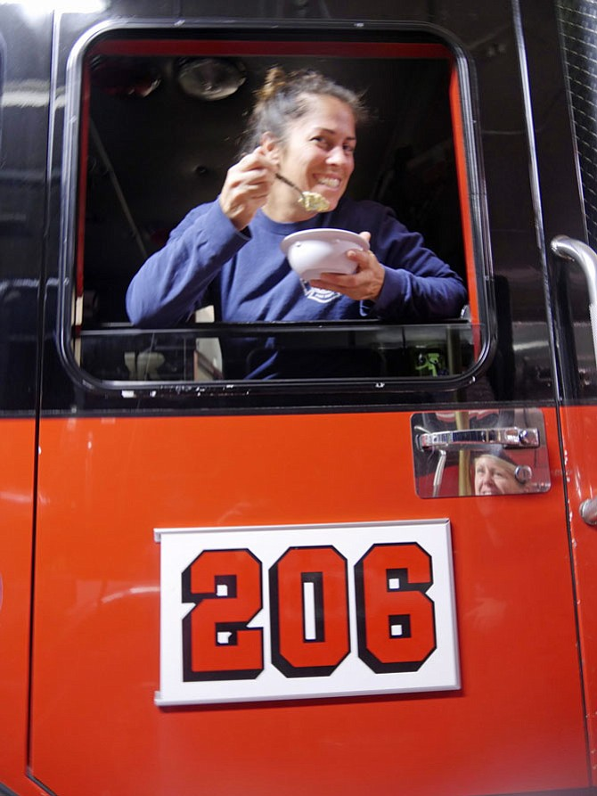 Kristina Holt from Station 206 on Seminary Road is winner of the City of Alexandria best firefighter chef contest. She shows off a bowl of her one of the favorite meals: chicken corn chowder.