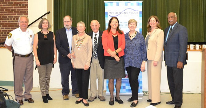 Volunteers and staff of Senior Services of Alexandria gather with city officials at the SSA Volunteer Appreciation luncheon Nov. 3 at the Durant Arts Center. From left: Sheriff Dana Lawhorne; Friendly Visitor of the Year Alexandra Johnson; Education Volunteer of the Year Steve Cordle; Meals on Wheels Volunteers of the Year Bobbie and Patrick O'Brien; Groceries to Go Volunteer Carolyn Caine; SSA Executive Director Mary Lee; Mayor Allison Silberberg; and SSA Board Chair Lynwood Campbell.