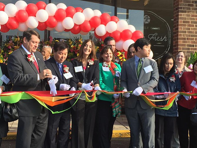 Del. Eileen-Filler Corn (D-41), Supervisor Pat Herrity (R-Springfield) and others participating in the ribbon cutting of the new H-Mart.